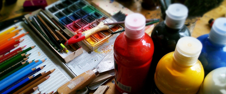bottles of paint, paint pallett, coloring pencils